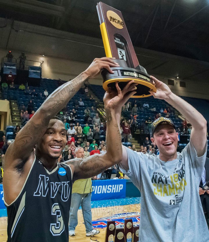 Nebraska Wesleyan's Deion Wells-Ross (3) and Cooper Cook celebrate after the NCAA men's Division III championship college basketball game at in Salem, Va., Saturday, March 17, 2018. NWU defeated Wisconsin-Oshkosh 78-72. (AP Photo/Don Petersen)