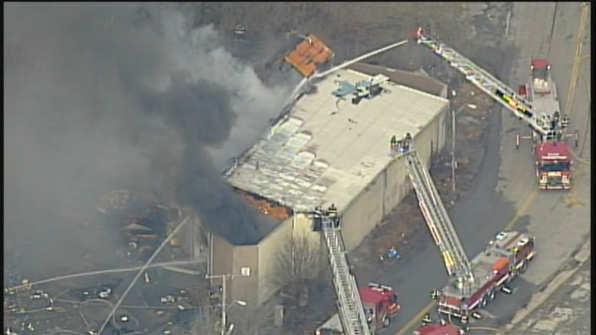 Fire crews spent hours Tuesday trying to put out a huge fire in a vacant building.  It happened at Interstate 70 and Van Brunt Boulevard. (Chopper5)