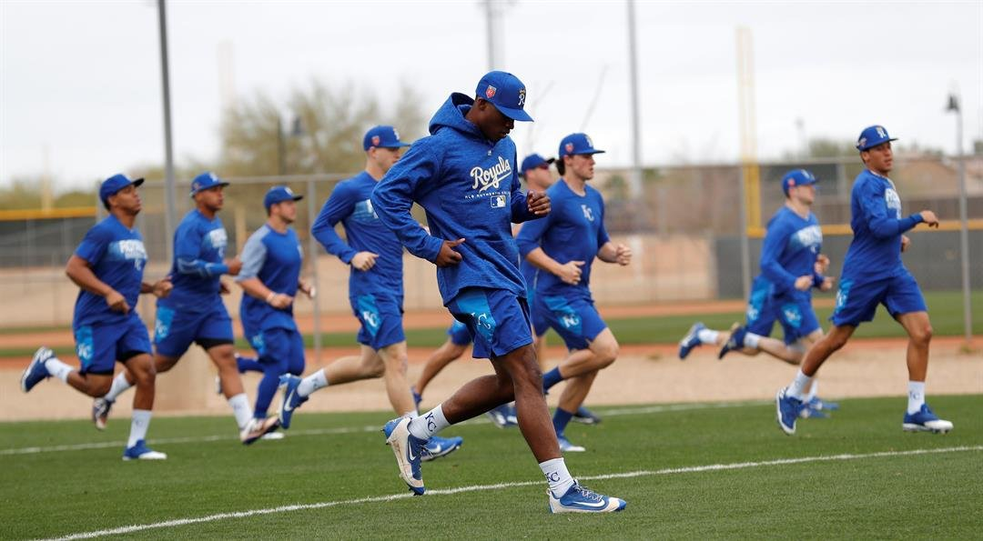 Kansas City Royals non-roster invitees run on a field during a baseball spring training workout, Tuesday, Feb. 13, 2018, in Surprise, Ariz. (AP Photo/Charlie Neibergall)