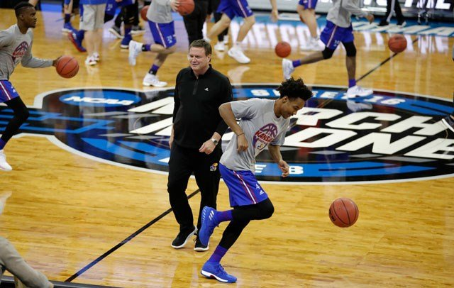 Kansas head coach Bill Self, left, walks past guard Devonte' Graham during practice at the NCAA men's college basketball tournament, Thursday, March 22, 2018, in Omaha, Neb. Kansas faces Clemson in a regional semifinal on Friday. (AP)