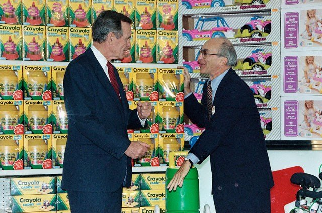 "Former President George H. Bush, listens to Toys ""R"" Us Chairman Charles Lazarus, right, Tuesday, Jan. 7, 1992 as he visits the U. S. based toy chain's second store to open in Japan. (AP Photo)"