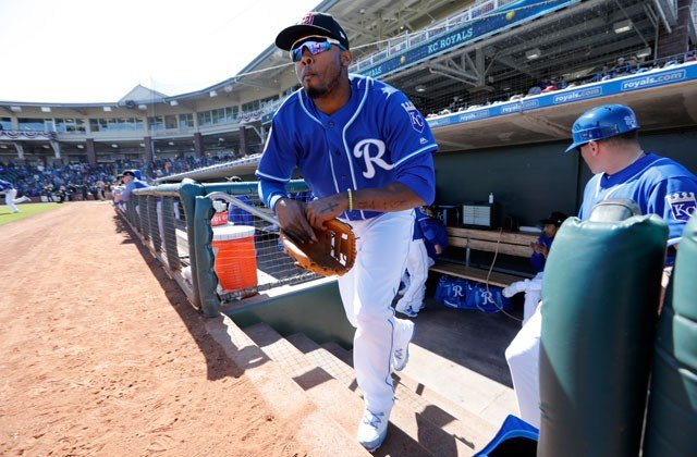 Kansas City Royals' Alcides Escobar runs onto the field at the start of a spring training baseball game against the Los Angeles Dodgers, Saturday, Feb. 24, 2018, in Surprise, Ariz. (AP Photo/Charlie Neibergall)