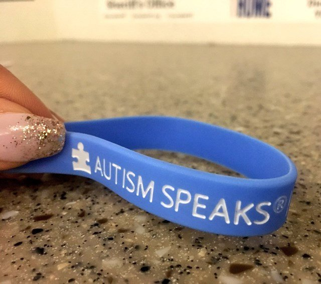 Employees will wear blue Autism Speaks bands, in support of Autism Awareness Month. (KCTV5)