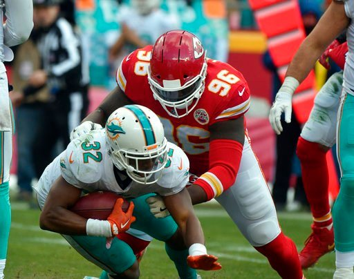Kansas City Chiefs defensive lineman Bennie Logan (96) tackles Miami Dolphins running back Kenyan Drake (32) during the second half of an NFL football game in Kansas City, Mo., Sunday, Dec. 24, 2017. (AP Photo/Ed Zurga)