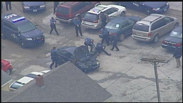 A man was taken away in handcuffs Monday after leading police on a wild pursuit Monday. It ended near 119th Street and Grandview Road. (Chopper5)