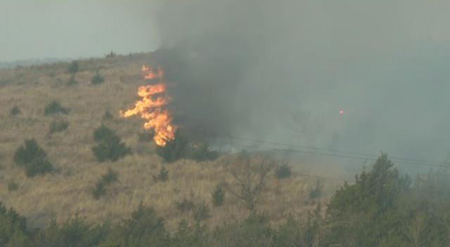 Some 450 people also have been evacuated in adjacent Woodward County, where a fire has burned 115,000 acres. (KCTV5)