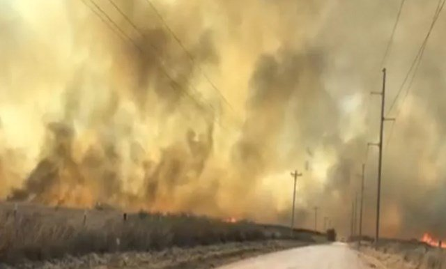 Firefighters are making more progress at another fire near Woodward, about 125 miles (201 kilometers) northwest of Oklahoma City. (CBS)