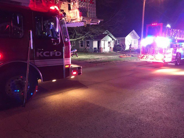 Firefighters say a single, vacant home caught fire before flames spread to houses on its north and south sides. (Kimo Hood/KCTV5)