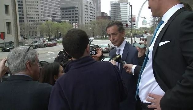 Al Watkins speaks to media outside a downtown St. Louis courthouse Monday afternoon. (KMOV)