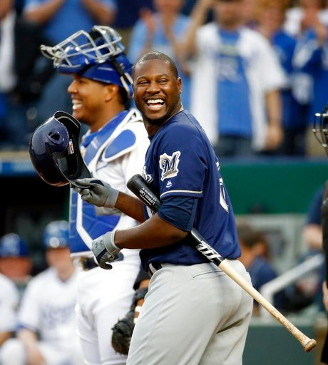 Milwaukee Brewers' Lorenzo Cain smiles at the crowd as they cheer the former Royal before his at bat during the first inning of a baseball game against the Kansas City Royals. (AP File Photo)