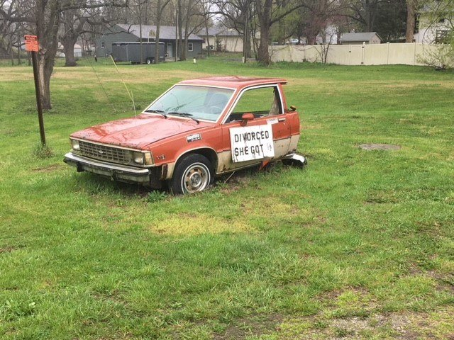 "The city of Edgerton is pressuring the owner of a cut-in-half car adorned with a sign reading, ""Divorced. She got ½,"" to junk the junker. (Rudy Harper/KCTV5 News)"
