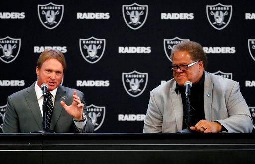 Oakland Raiders head coach Jon Gruden and general manager Reggie McKenzie. (AP Photo)