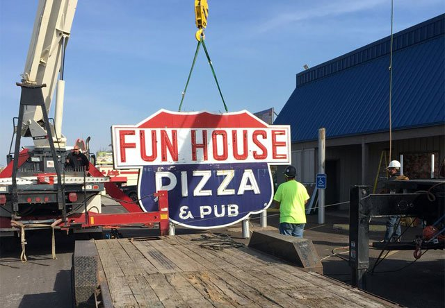 The iconic Fun House Pizza sign on Missouri Highway 350 was taken down Monday and will now become part of Kansas City history. (Kelli Taylor/KCTV5 News)