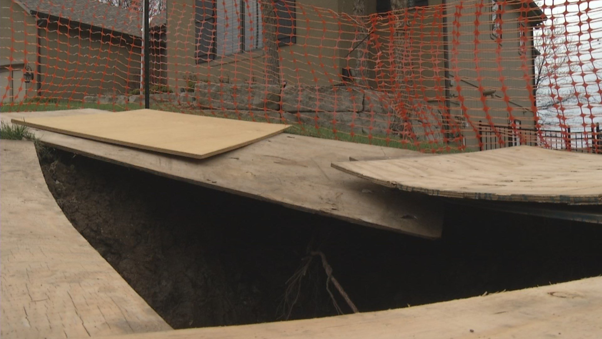Six weeks ago, Kansas City WaterServices went searching for an underground manhole they hoped to raise to ground level. They showed up at the O'Bar's home and began digging. (KCTV5)