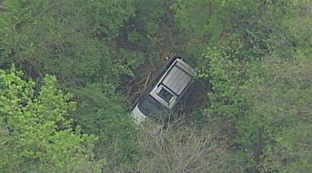 The SUV continued to roll and ended up in a ditch. (KCTV5)