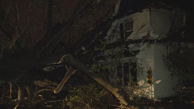 Two adults and three children were inside the house, located in the 8300 block of Raytown Road when a massive tree came crashing through their walls. (KCTV5)