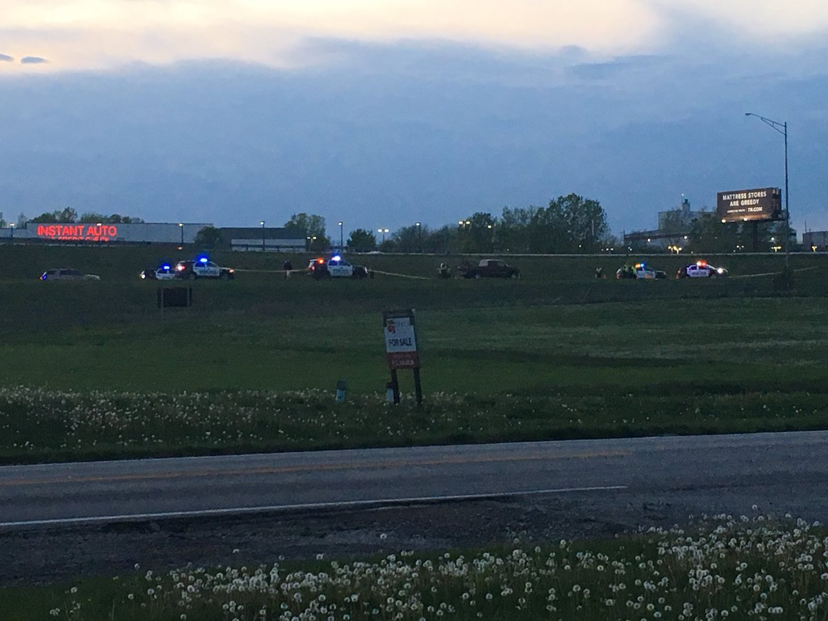 A man was found dead on the side of the highway after drivers reported a man bleeding. (Nathan Vickers/KCTV5)