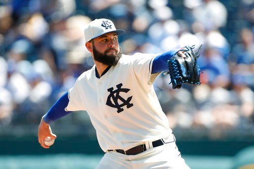The Kansas City Royals won a series for the first time in 11 tries this season, beating the Detroit Tigers 4-2 Sunday as Mike Moustakas drove in three runs with a double and sacrifice fly. (AP Photo)