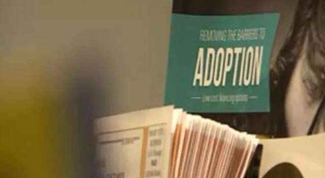 Paperwork on a desk at a St. Louis adoption agency. (Credit: KMOV)