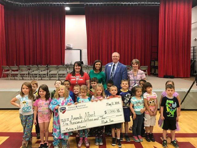 Kindergarten teacher Amanda Albert received a $1,000 check from Kansas' chapter of the National Education Association. (KCTV5)