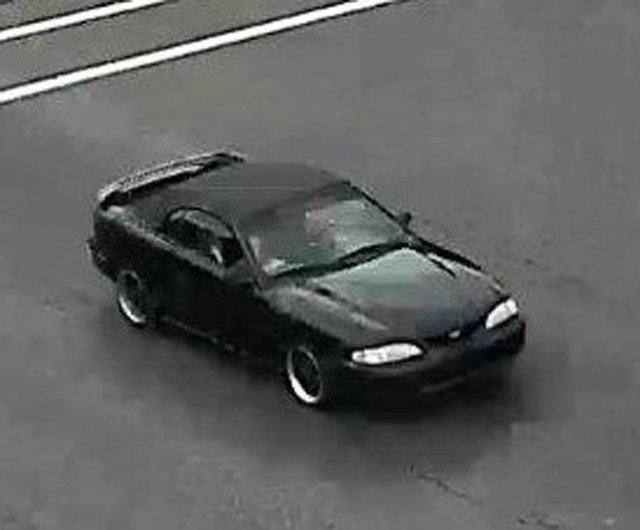 Police say the suspect is an African-American man in his 20s, with short hair and driving a late 1990's or early 2000's black Ford Mustang convertible with an unknown Georgia license plate. (Lenexa PD)