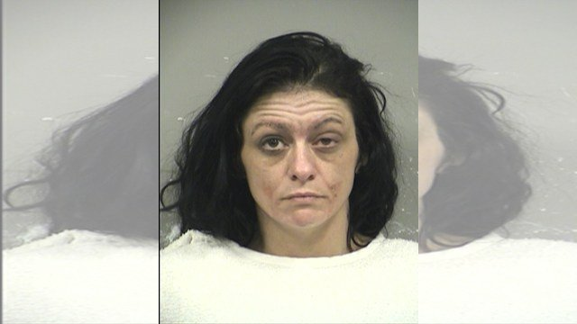 Officers took 36-year-old Bridget L. Depriest into custody and was issued summons for trespassing and openly burning resulting in property damage. (KCPD)