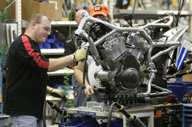 An unidentified worker assembles a motorcycle on line at the Harley Davidson plant in Kansas City, Mo., Friday, Jan. 6, 2006. (AP Photo/Orlin Wagner)