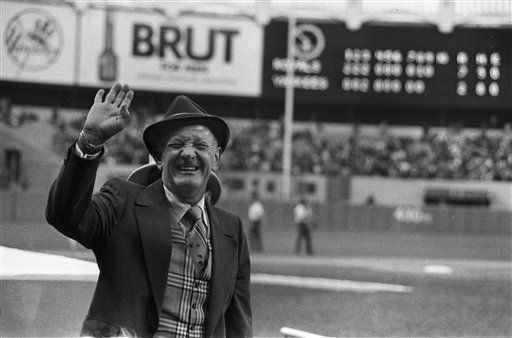 In this October 1977 file photo, Kansas City Royals president Ewing Kauffman waves to fans at Yankee Stadium after the Royals defeated the New York Yankees 7-2 in an American League baseball playoff game in New York. (AP)