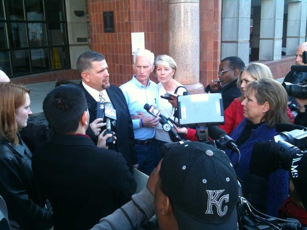 Clay County Prosecutor Dan White surrounded by Renee Pernice's family, media