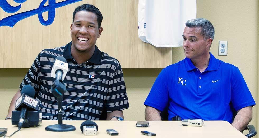 © Kansas City Star photo. Catcher Salvador Perez, Royals GM Dayton Moore