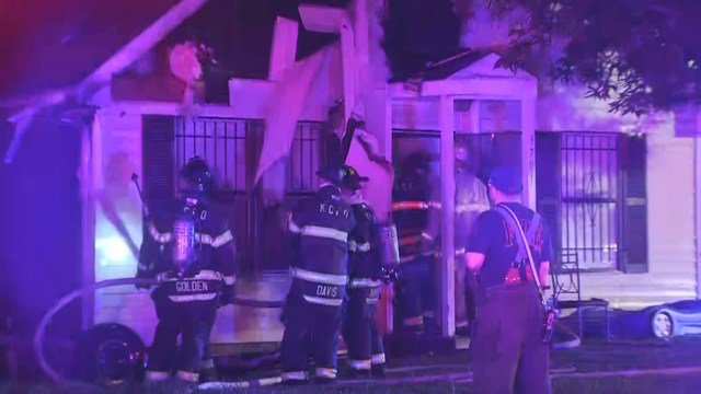 When fire crews arrived, the fire had spread and flames were seen at both homes. (KCTV5)