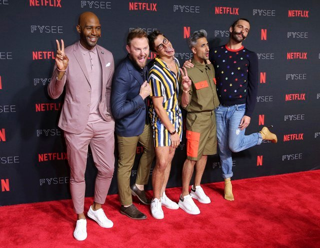 "Karamo Brown, from left, Bobby Berk, Antoni Porowski, Tan France and Jonathan Van Ness play around at the ""Queer Eye"" FYC Event at the Netflix FYSee at Raleigh Studios on Thursday, May 31, 2018, in Los Angeles. (Photo by Willy Sanjuan/Invision/AP)"