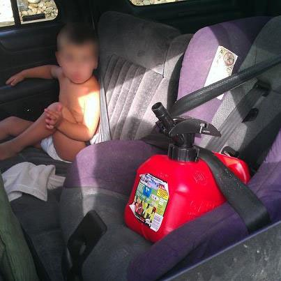 "Handout from the Aurora, CO police. They came across a vehicle during a ""Click It or Ticket"" stop where a gas can was in a child safety seat, but an infant was merely in a lap belt. (Aurora Police)"
