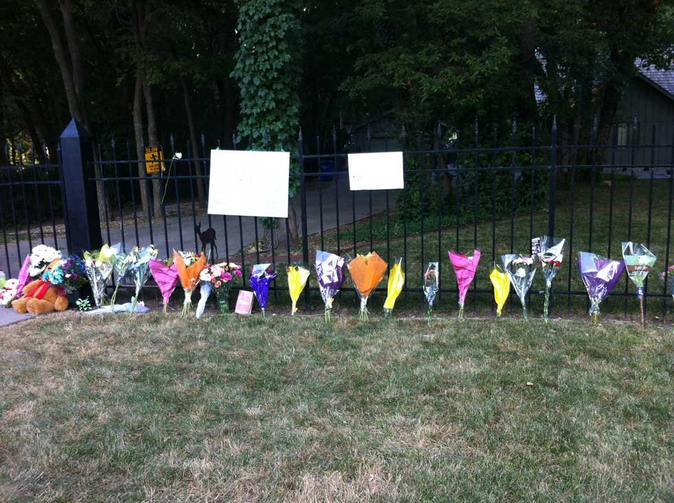 Flowers and items left outside the Bramlage family home in Junction City