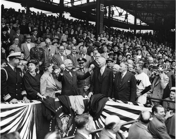 President Truman holding up two balls at the April 18, 1950 opening game of Washington Senators vs Philadelphia Athletics at Griffith Stadium in Washington, D.C. He was known for pitching both left and right handed. Photo Courtesy: Harry Truman Library