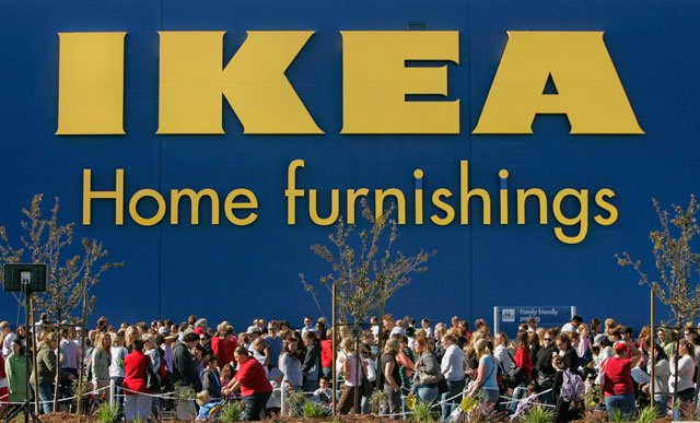 Customers work their way through a winding line to enter the new IKEA store for its grand opening, Wednesday, May 23, 2007, in South Jordan, UT. (AP Photo/Douglas C. Pizac)