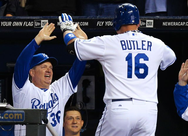 Kansas City Royals' Billy Butler (16) celebrates his two-run home run with Kevin Seitzer (36) and David Lough (7) in the ninth inning of a baseball game against the Los Angeles Angels on Saturday, Sept. 15, 2012, in Kansas City, Mo.  (AP Photo/Ed Zurga)