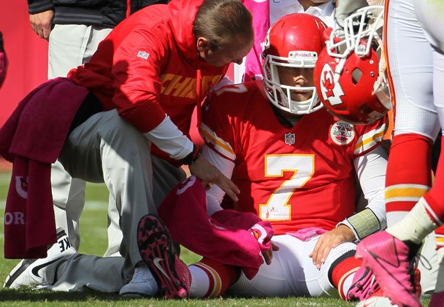 Trainers assist Kansas City Chiefs quarterback Matt Cassel (7) during the second half of an NFL football game against the Baltimore Ravens at Arrowhead Stadium in Kansas City, Mo., Sunday, Oct. 7, 2012.  (AP Photo/Colin E. Braley)