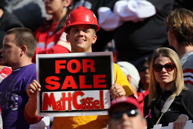A Kansas City Chiefs fan hold a sign after Chiefs quarterback Matt Cassel was injured in the 4th quarter of an NFL football game against the Baltimore Ravens, Sunday, Oct. 7, 2012, in Kansas City, MO. (AP Photo/Colin E Braley)