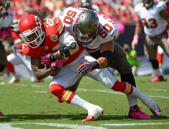 Kansas City Chiefs wide receiver Dexter McCluster (22) is tackled by Tampa Bay Buccaneers defensive tackle Daniel Te'o-Nesheim (50) after a reception during the first half on Sunday in Tampa, Fla. (AP Photo/Phelan M. Ebenhack)
