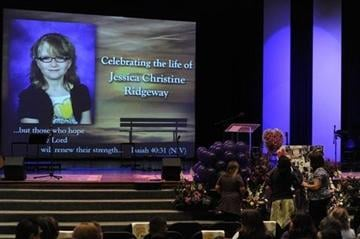 (AP Photo/The Denver Post, Kathryn Scott Osler). Friends and family gather at the altar just befor the start of a memorial service for 10-year-old Jessica Ridgeway at Faith Bible Chapel in Arvada on Tuesday, Oct. 16, 2012.