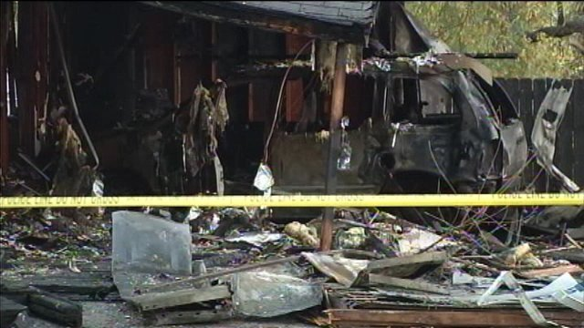 Three men were taken to area hospitals after a minivan went up in flames Monday morning after it slammed into a house on the city's south side.