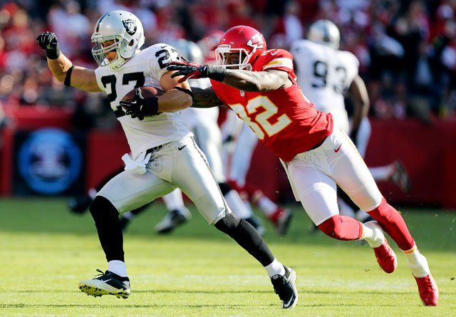 Oakland Raiders free safety Matt Giordano (27) is tackled by Kansas City Chiefs wide receiver Dwayne Bowe (82) after an interception during the first half at Arrowhead Stadium in Kansas City, Mo., Sunday, Oct. 28, 2012. (AP Photo/Ed Zurga)