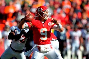 Kansas City Chiefs quarterback Brady Quinn (9) passes to a teammate during the first half of an NFL football game against the Denver Broncos at Arrowhead Stadium in Kansas City, Mo., Sunday, Nov. 25, 2012.  (AP Photo/Ed Zurga)