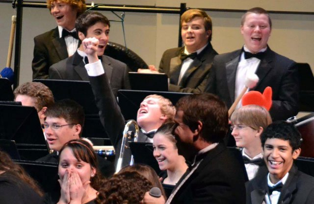 Members of the Liberty North high school symphonic band react when their band teacher surprises them by announcing the marching band has been selected to participate in President Barack Obamas Inaugural Parade. (Image courtesy Monty Davis)