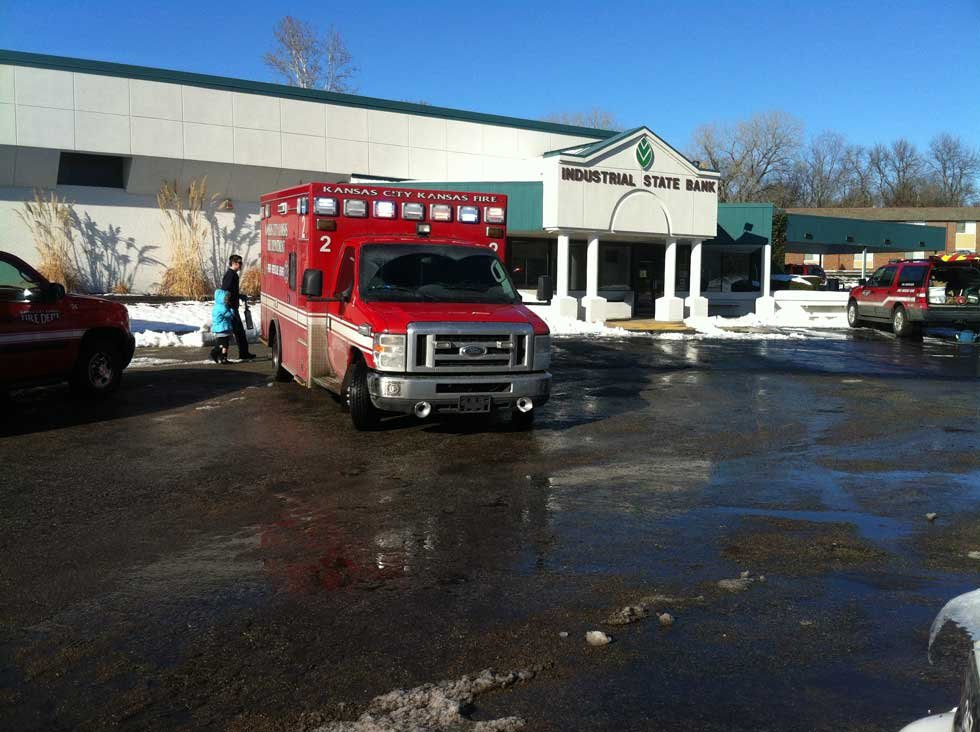 Child walks to ambulance outside Kiddle Castle daycare