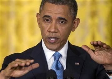 (AP Photo/Carolyn Kaster). President Barack Obama gestures as he speaks during the last news conference of his first term in the East Room of the White House in Washington, Monday, Jan. 14, 2013.