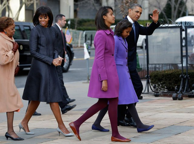 President Barack Obama, waves as he walks with his daughters Sasha and Malia, first lady Michelle Obama and mother-in-law Marian Robinson, to St. John's Church in Washington on Monday for a church service during the 57th Presidential Inauguration. (AP)