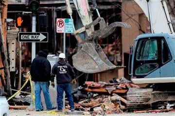(AP Photo/Ed Zurga). Two men look at the rubble of JJ's restaurant after an explosion and fire tore through the establishment Tuesday evening near the Country Club Plaza Wednesday, Feb. 20, 2013, in Kansas City, Mo.