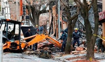 (AP Photo/Orlin Wagner). Officials inspect a burned out JJ's Restaurant at the Plaza shopping district of Kansas City, Mo., Wednesday, Feb. 20, 2013.